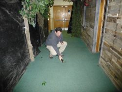 Author and paranormal investigator Richard Estep, attempting to determine whether a K2 spike can be attributed to cabling running under the floor.