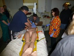 Richard intubates (places a breathing tube) while Sean does chest compressions.