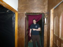 Richard Estep with the door that slammed violently behind him an instant after he had past through the doorway.